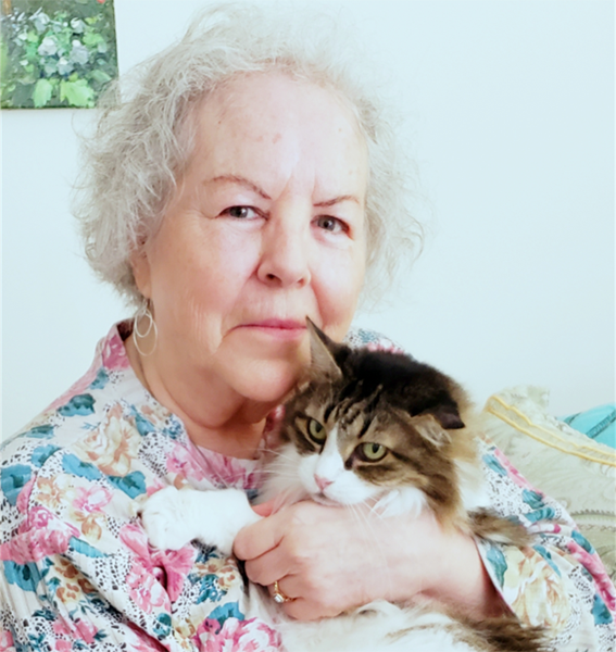 Senior with Her Cat at Cabot Cove of Largo Assisted Living