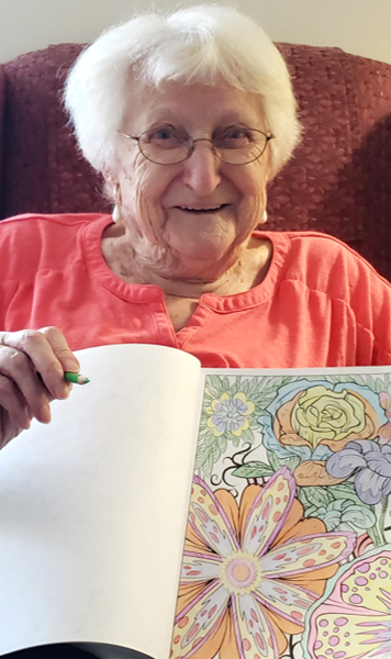Seniors having fun coloring at Cabot Cove of Largo Assisted Living