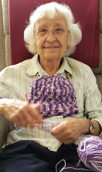 Seniors having fun knitting at Cabot Cove of Largo Assisted Living